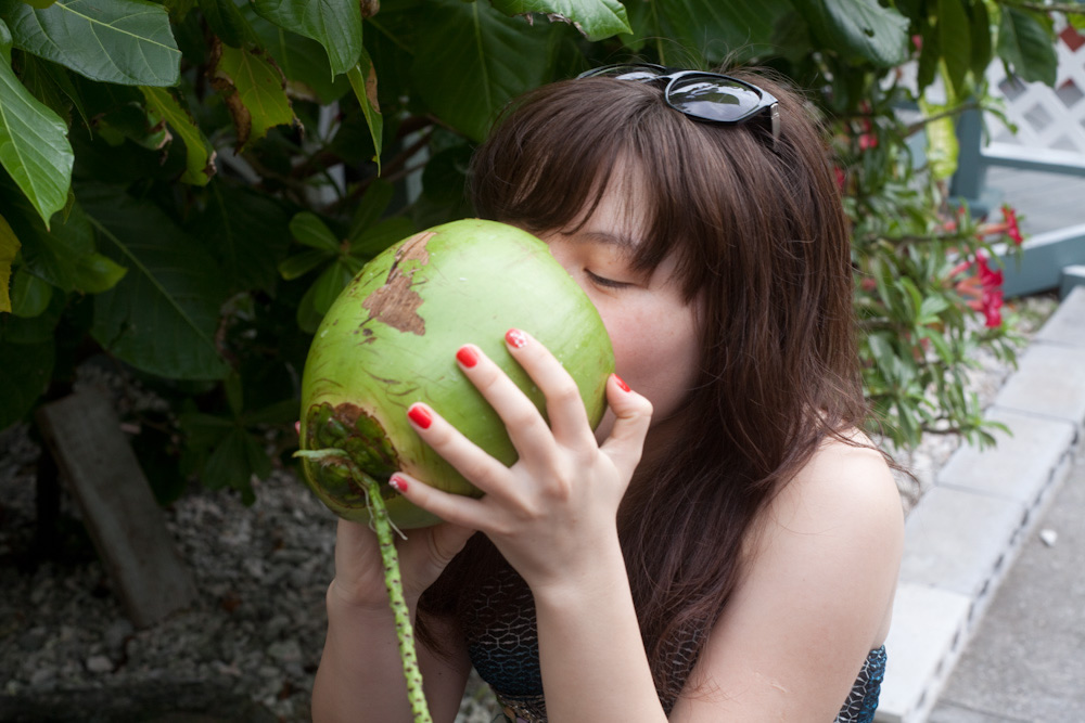 Aidana drinking coconut juice